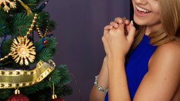 bright picture of woman decorating christmas tree