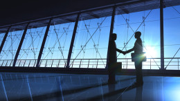 Business shake hand silhouettes rendered with computer graphic.
