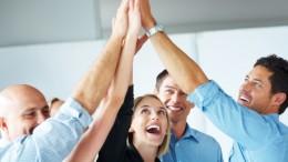 Teamwork and team spirit - Businesspeople celebrating success