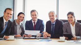 Portrait of businesspeople in conference room during meeting