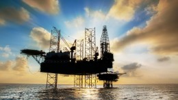 Silhouette,Offshore oil and rig platform in sunset or sunrise time. Construction of production process in the sea. Power energy of the world.