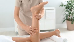 Woman receiving leg massage in wellness center
