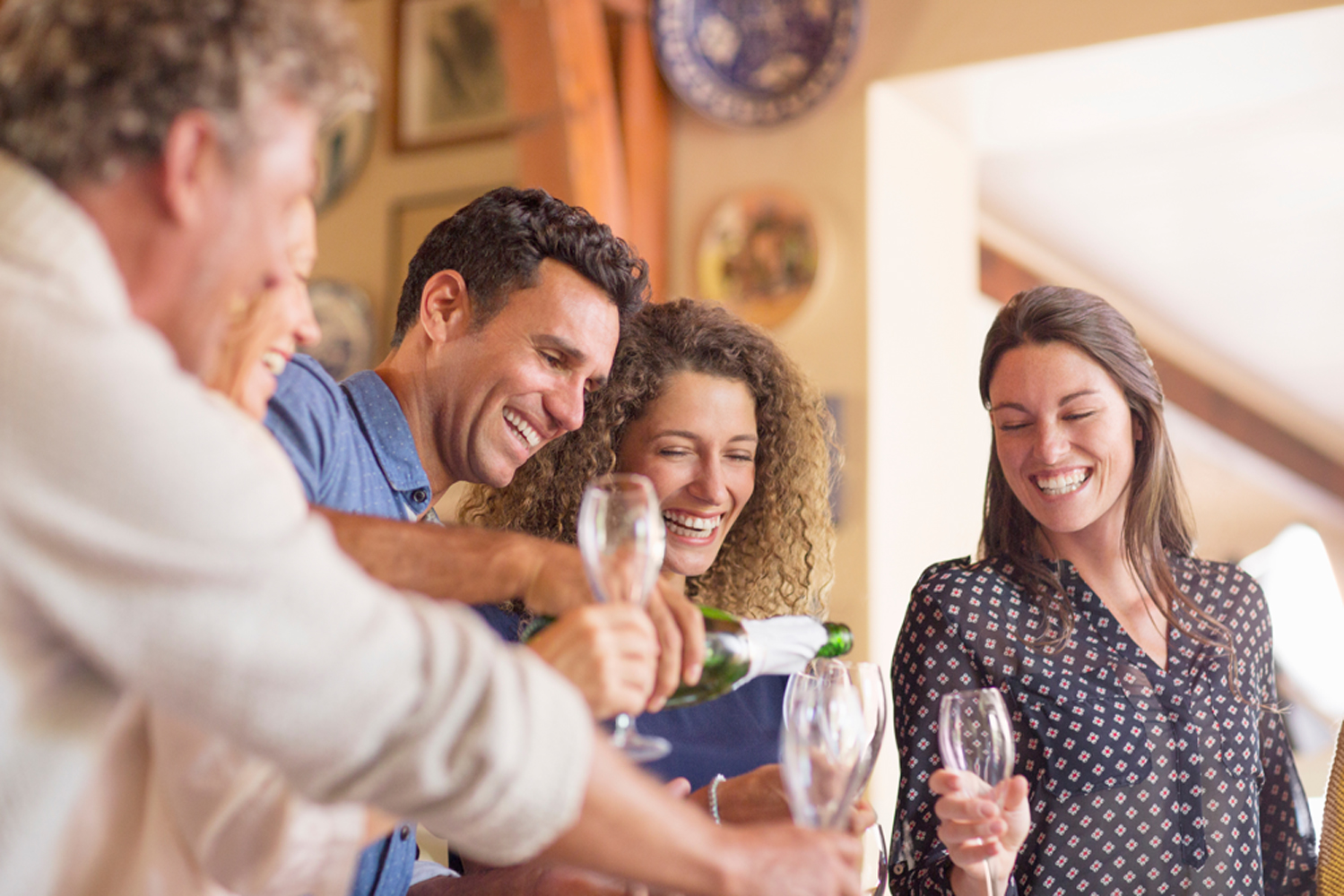 Man pouring drinks to family membersImage downloaded by Dr. Andreas Erber at 7:00 on the 19/12/18