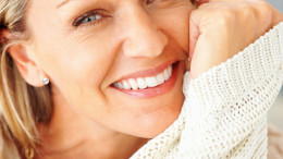 Detail shot of an attractive Caucasian woman giving you warm smile