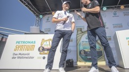 "STUTTGART, GERMANY – JULY 24th: F1 Mercedes-AMG PETRONAS Motorsport Team driver Valtteri Bottas, special guest of ""PETRONAS Syntium Retail Launch - Valtteri Bottas at Stuttgart"", answers to questions by the popular German anchorman Martin Kloss."