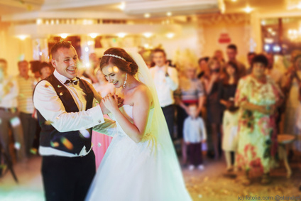 Happy bride and groom and their first dance, wedding in the elegant restaurant with a wonderful light and atmosphere