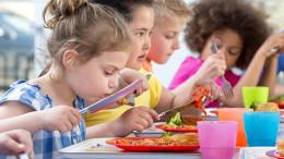 School children enjoying their school dinners