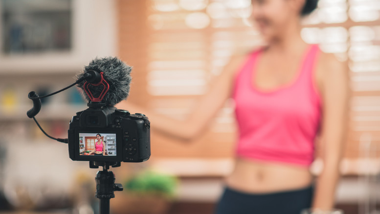 Young Asian blogger woman exercise and looking to camera in kitchen, Attractive beautiful female working out for healthy at home. Woman exercise at home concept.