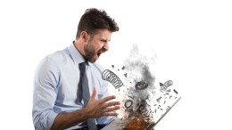 Stress and frustration of a businessman caused by a computer