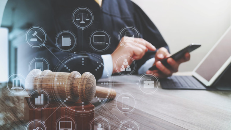 justice and law concept.Male judge in a courtroom with the gavel,working with smart phone,digital tablet computer docking keyboard on wood table,virtual interface graphic icons diagram