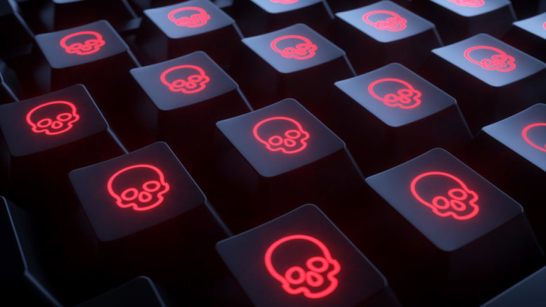 Closeup keyboard with skulls. Infected computer.