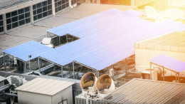 Solar cell panel on the rooftop of office or factory building wi